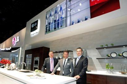 Top product designer Nate Berkus and two men from LG standing in concept kitchen featuring LG Studio lineup at CES 2014
