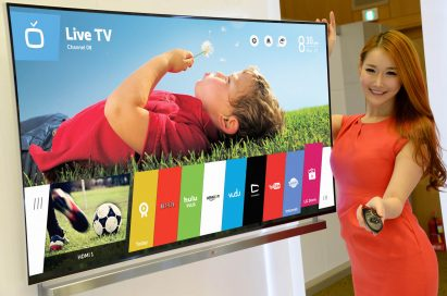 A model showing off LG's new Smart TV platform webOS with the Magic Remote in her hand