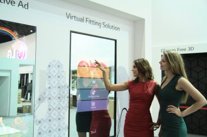 Two models demonstrating the Virtual Fitting solution available on LG's 55-inch Fulll HDLG Board at ISE2014