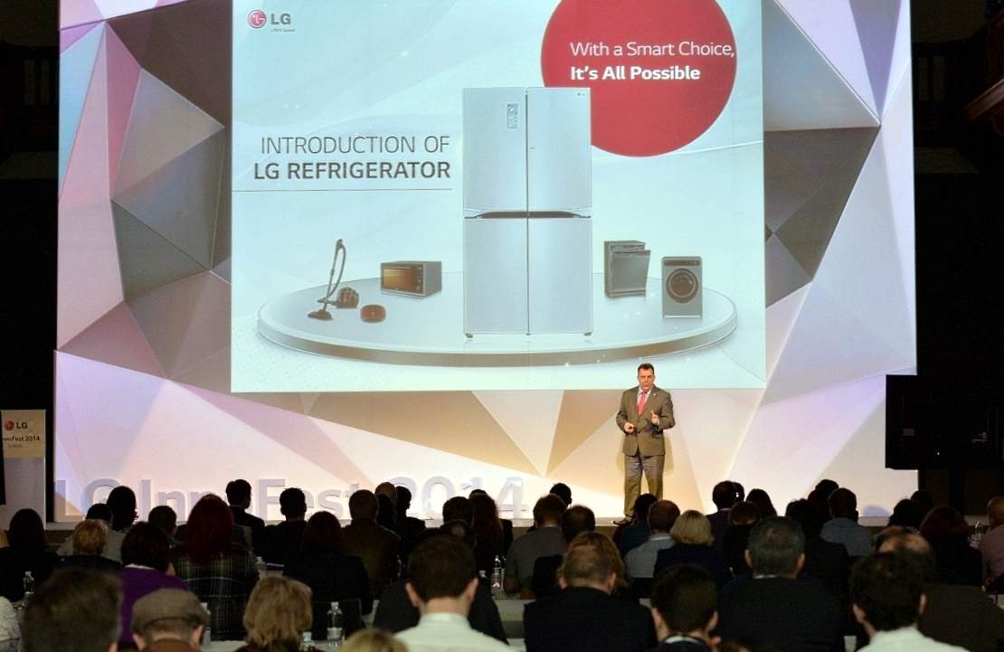 An LG representative explains the LG Refrigerator to visitors on stage at LG Innovative Festival Europe