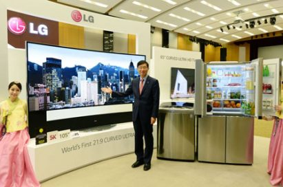 Weon-dae Kim, senior vice president and regional head of LG Electronics Asia, poses with its newest products aimed at Asian consumers.