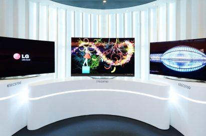 Three LG 4K OLED TVs, model 65EC9700 and model 77EG9700, on display