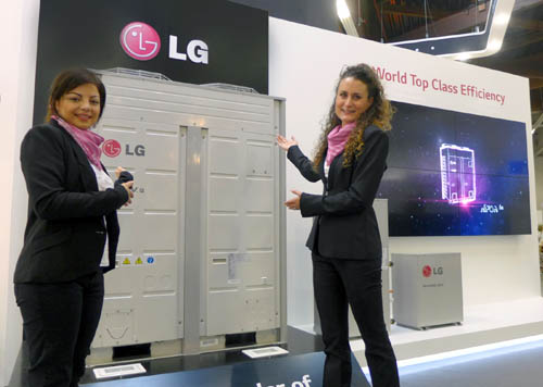 Ladies pointing LG's latest HVAC product at Chilventa 2014