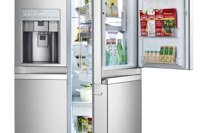 LG Multi-Door refrigerator with its right door including Door-in-Door part open. The refrigerator is filled up with various food such as beverages and fruits.