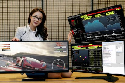 A model demonstrating LG UltraWide Gaming Monitor 34UM67 and Curved UltraWide Multi-Display model 34UC87M