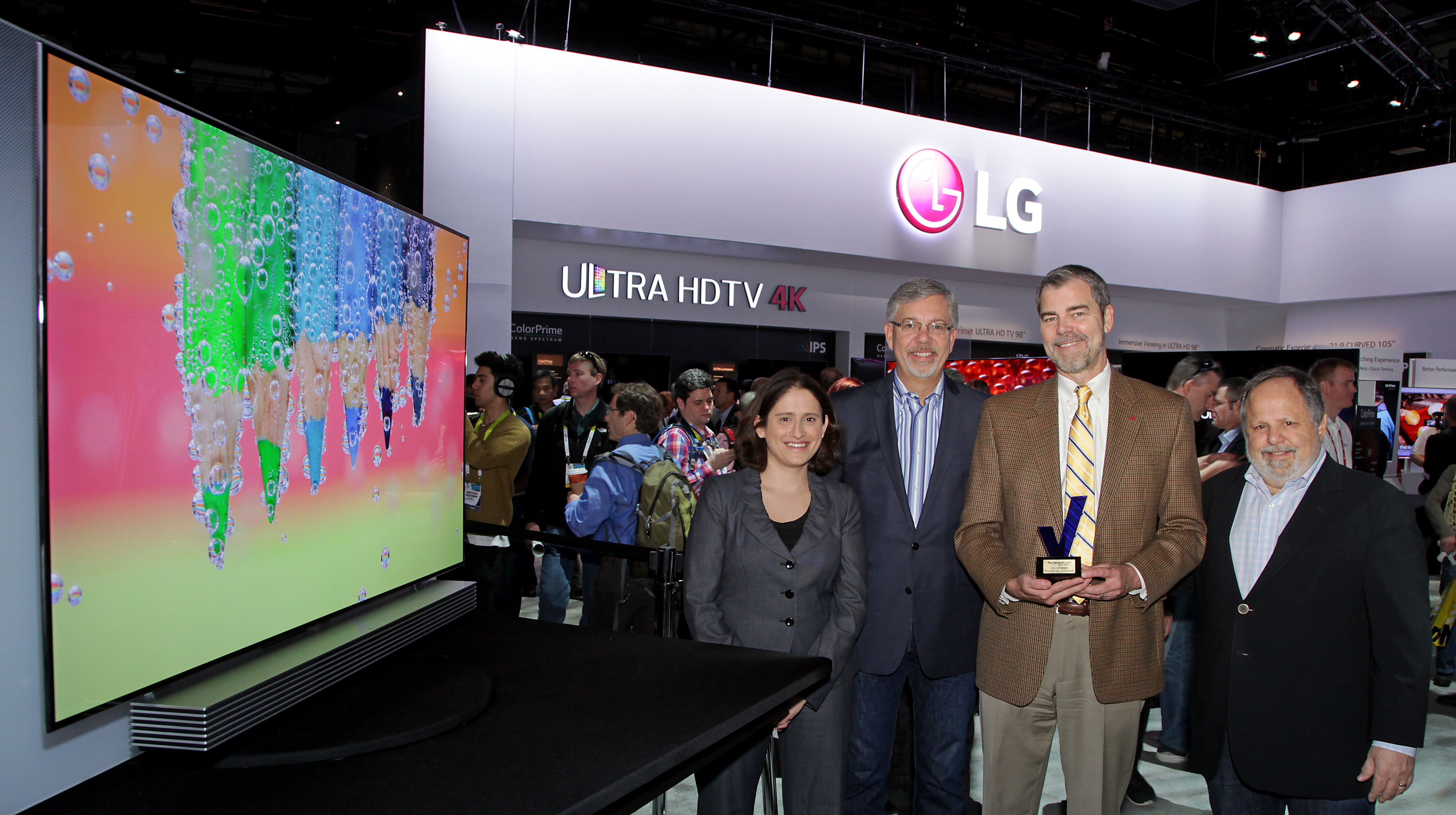 David VanderWaal, director of home appliance brand marketing, LG Electronics USA (third from left), holds one of the awards earned at CES 2015, and takes a group picture with colleagues