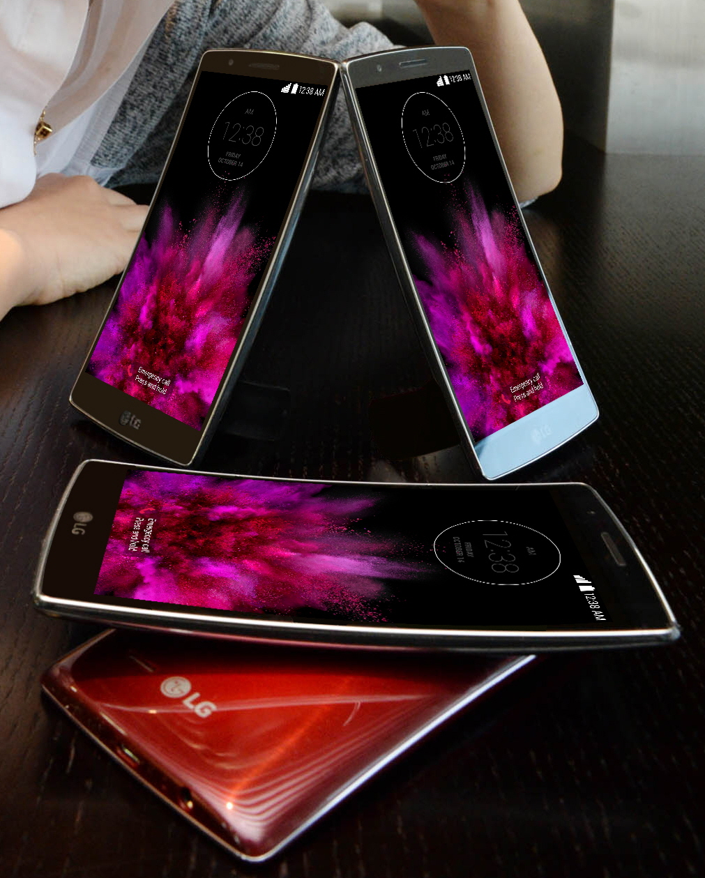 Two LG G Flex2s are standing on the table showing their fronts and other twos are lying on the table – each showing front and back.