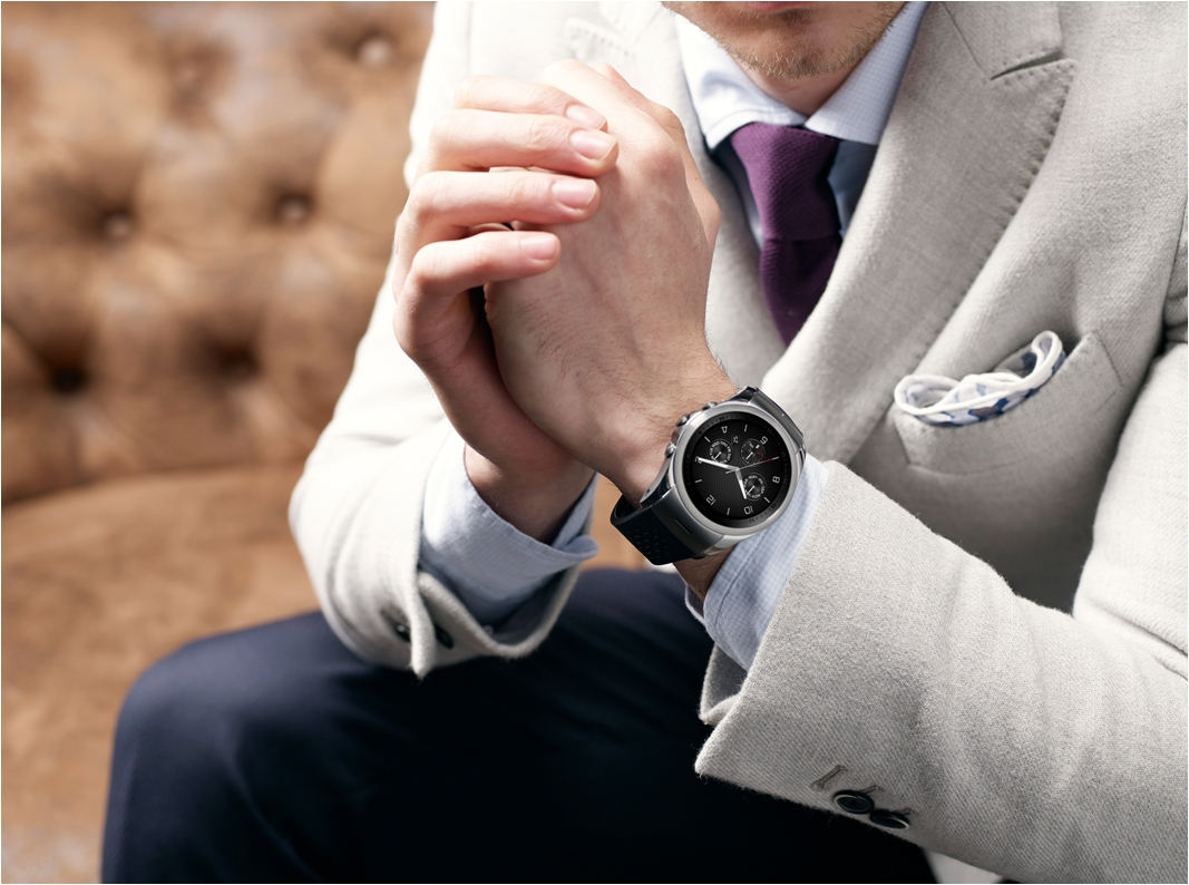 A man holds his hands together while wearing the LG Watch Urbane LTE.