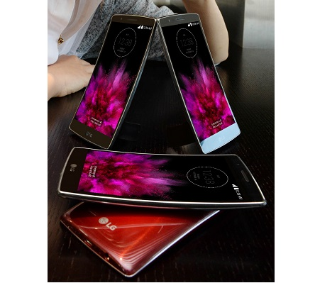 Four LG G Flex 2 smartphones in each color variant are placed on the table and a female model poses behind those sample phones.
