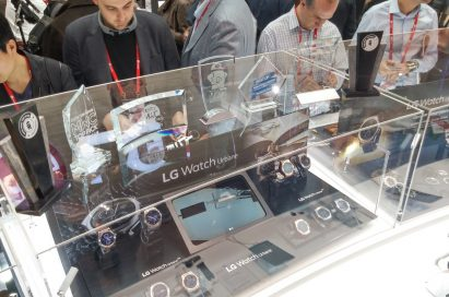 Participants of MWC are looking at LG Watch Urbanes at LG booth.