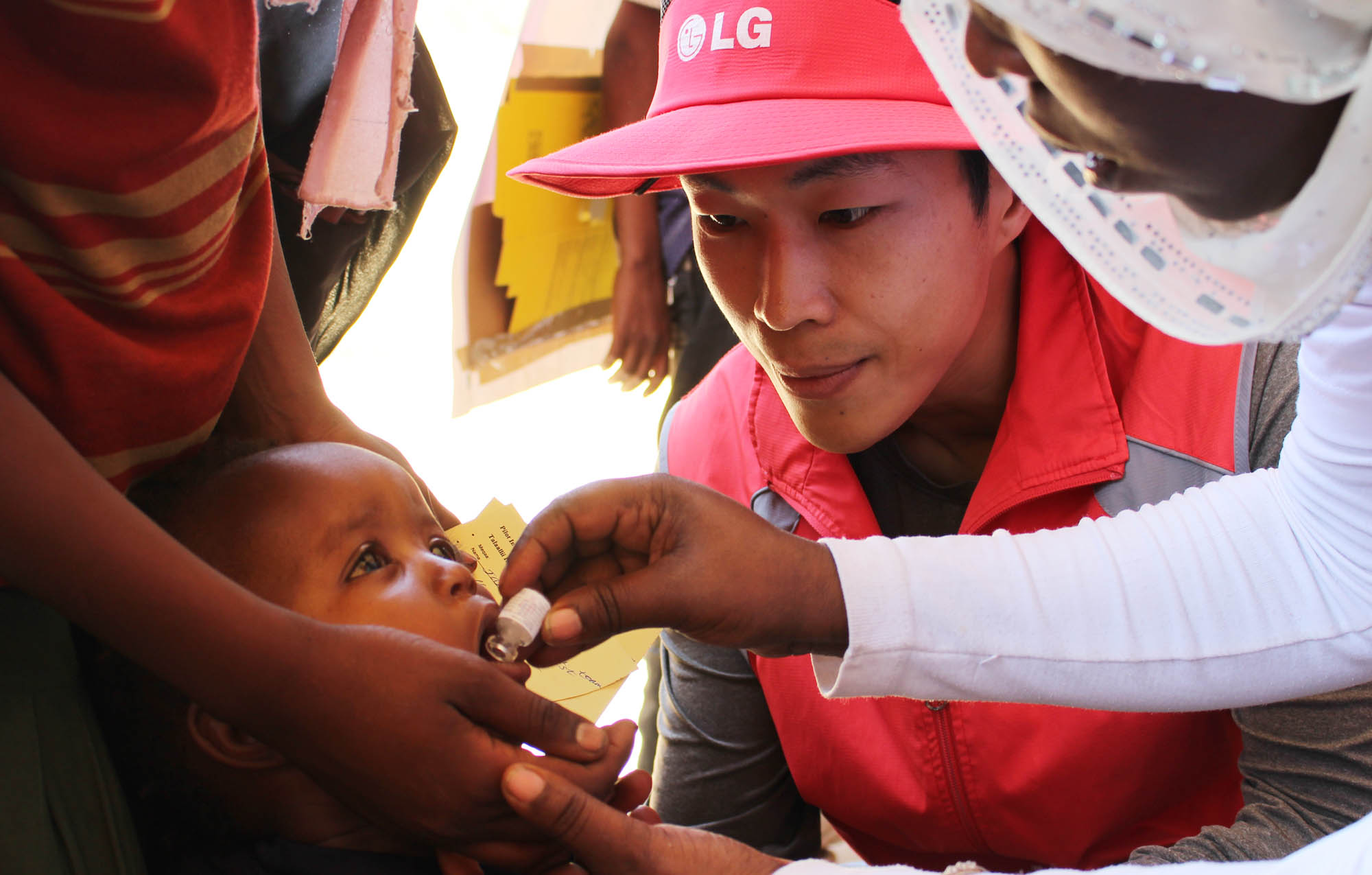 A child gets an oral cholera vaccination.