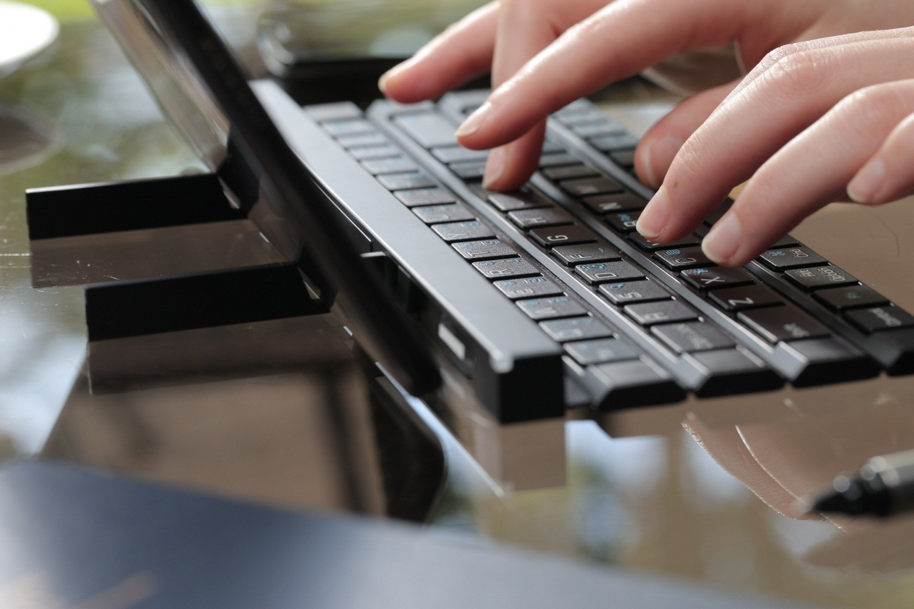A woman typing with the Rolly Keyboard.