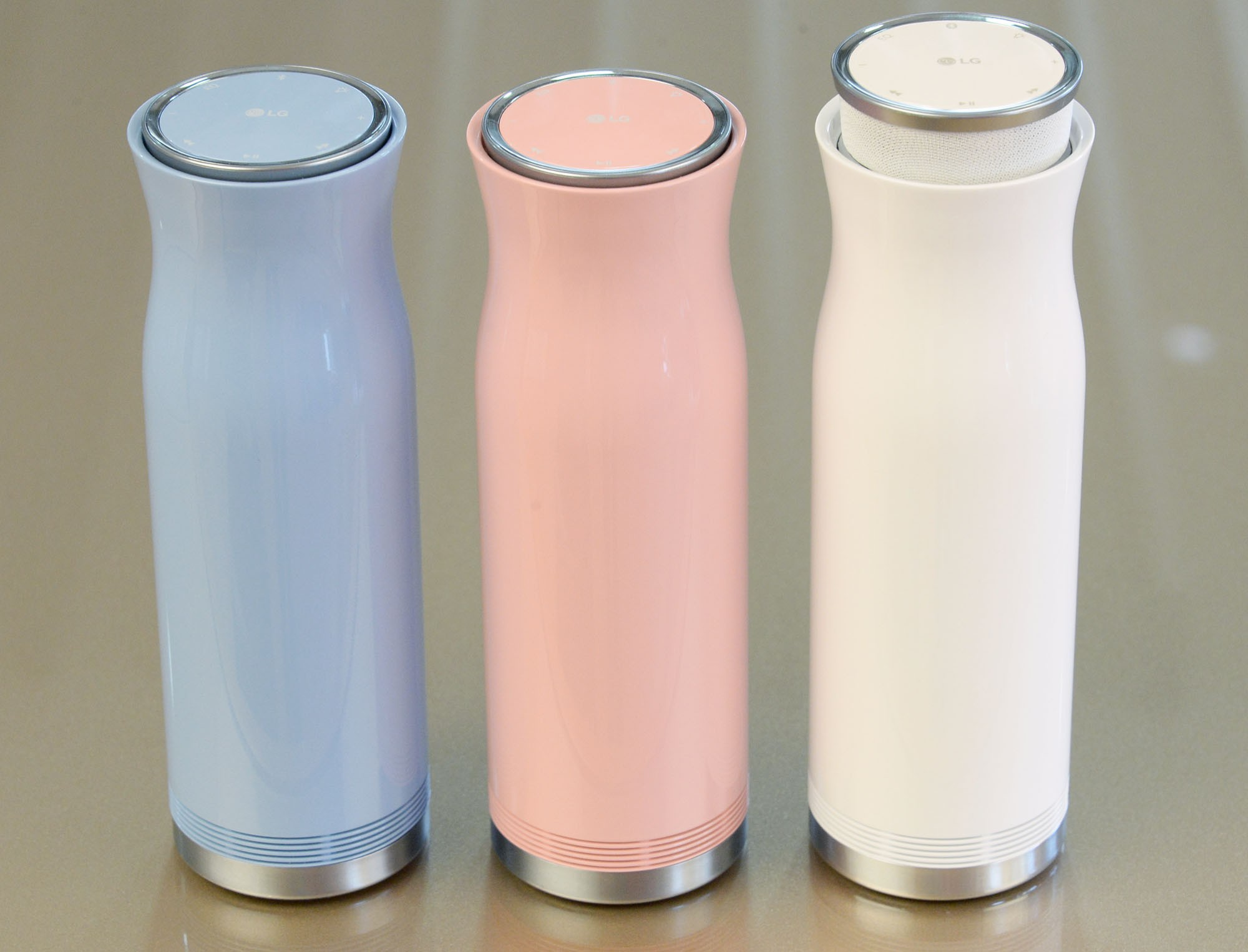 Three side-by-side LG SoundPop 360 models in pink, white and light blue
