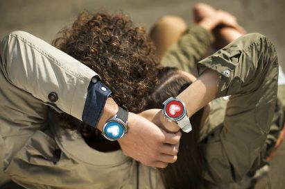 A man and woman are holding hands with the LG Watch Urbane 2nd Edition on both their wrists