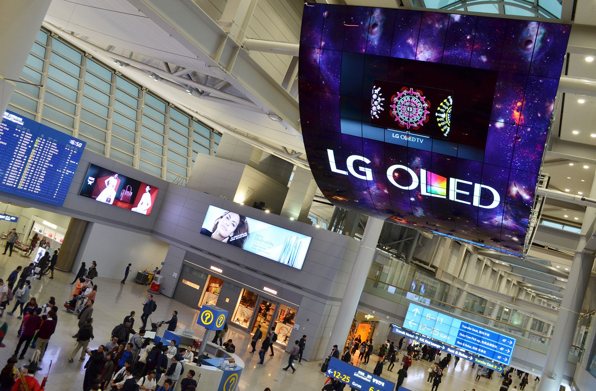 A ceiling installation of LG OLED Signage displaying artwork at Incheon International Airport