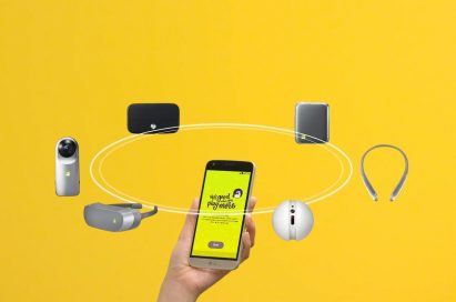 A person holds the LG G5 in Silver, with the LG G5 friends (LG 360 CAM, LG Hi-Fi Plus with B&O PLAY, LG CAM Plus, LG TONE Platinum™, LG Rolling Bot, LG 360 VR) rotating above it
