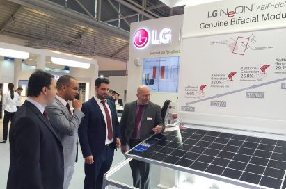 People surround and discuss the LG NeON™ 2 BiFacial solar module at LG's Intersolar Europe booth.