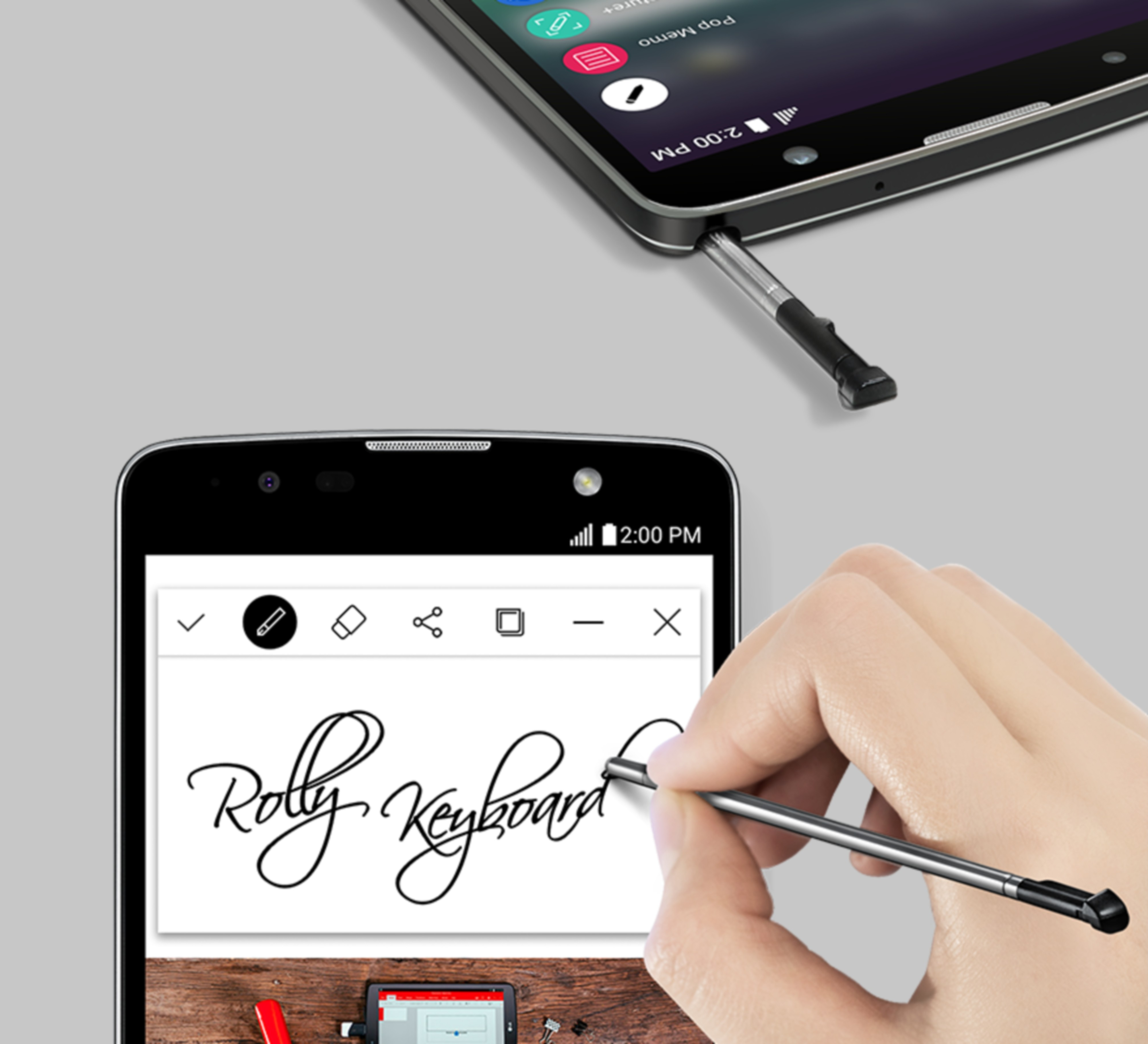 A person using the stylus to write 'Rolly Keyboard' in cursive on the LG Stylus 2 Plus