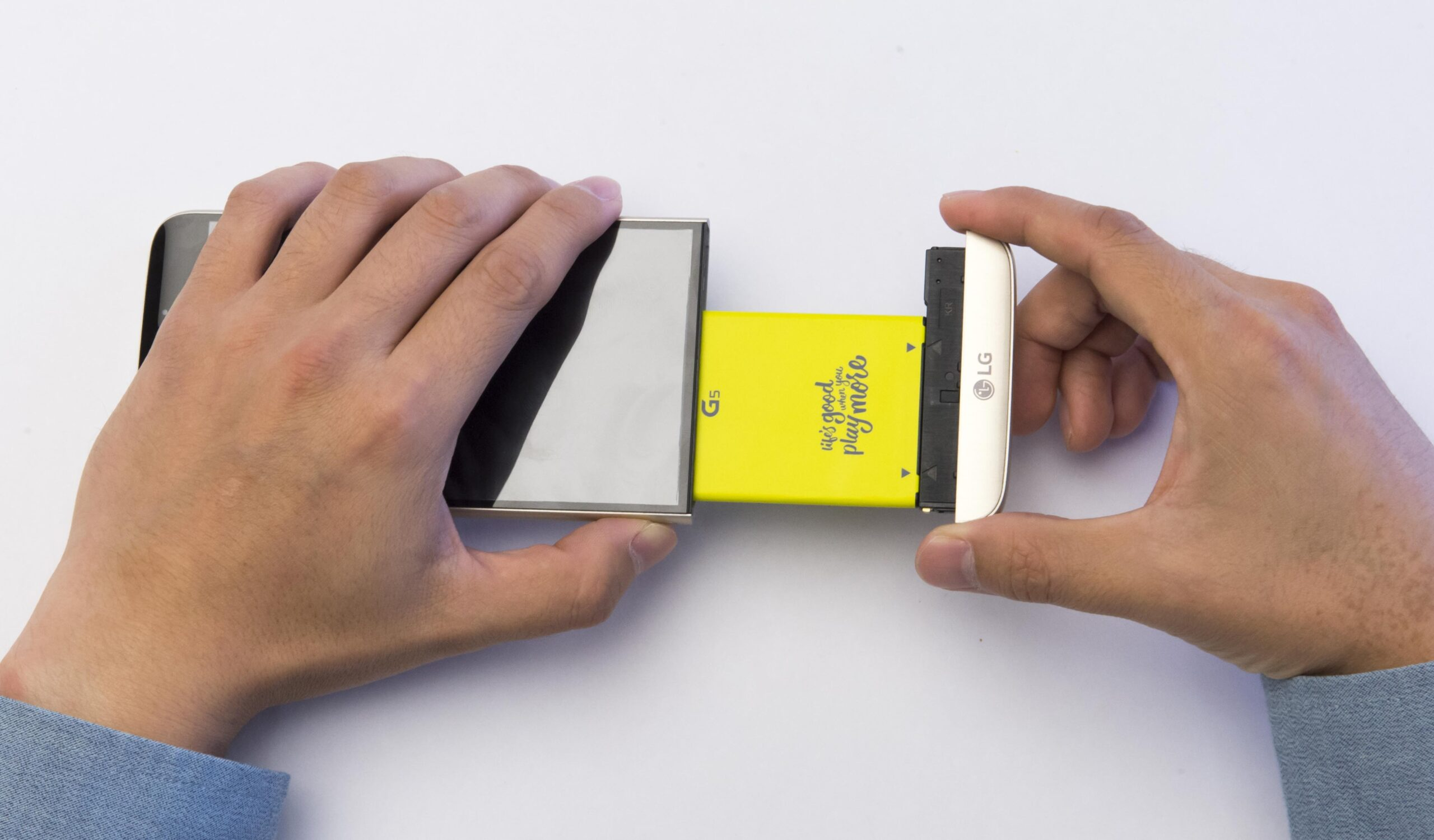 Battery and lower section of LG G5 modular smartphone being removed