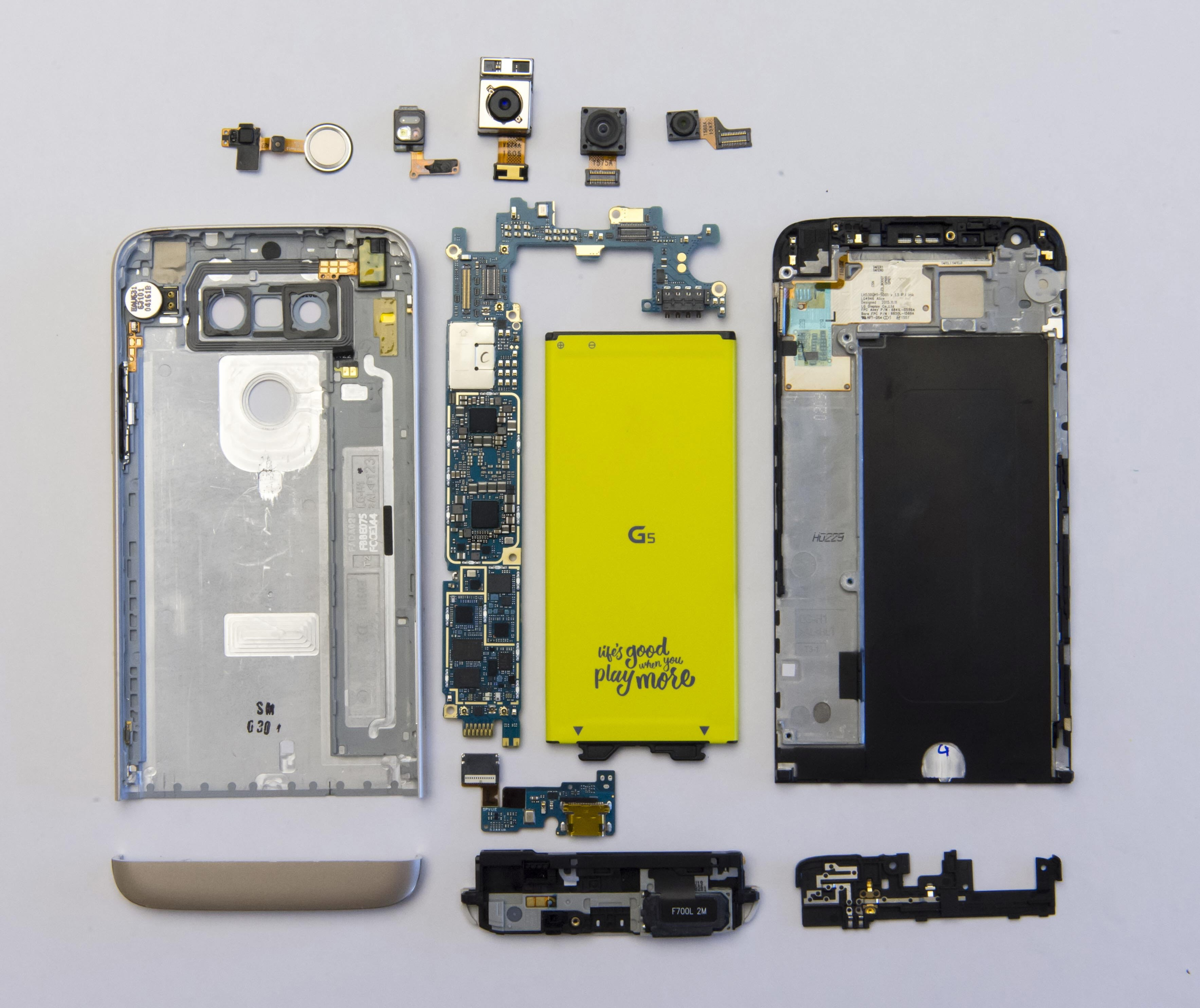All modular components of LG G5 laid out on flat surface