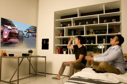Two men playing a video game with the LG Minibeam projector