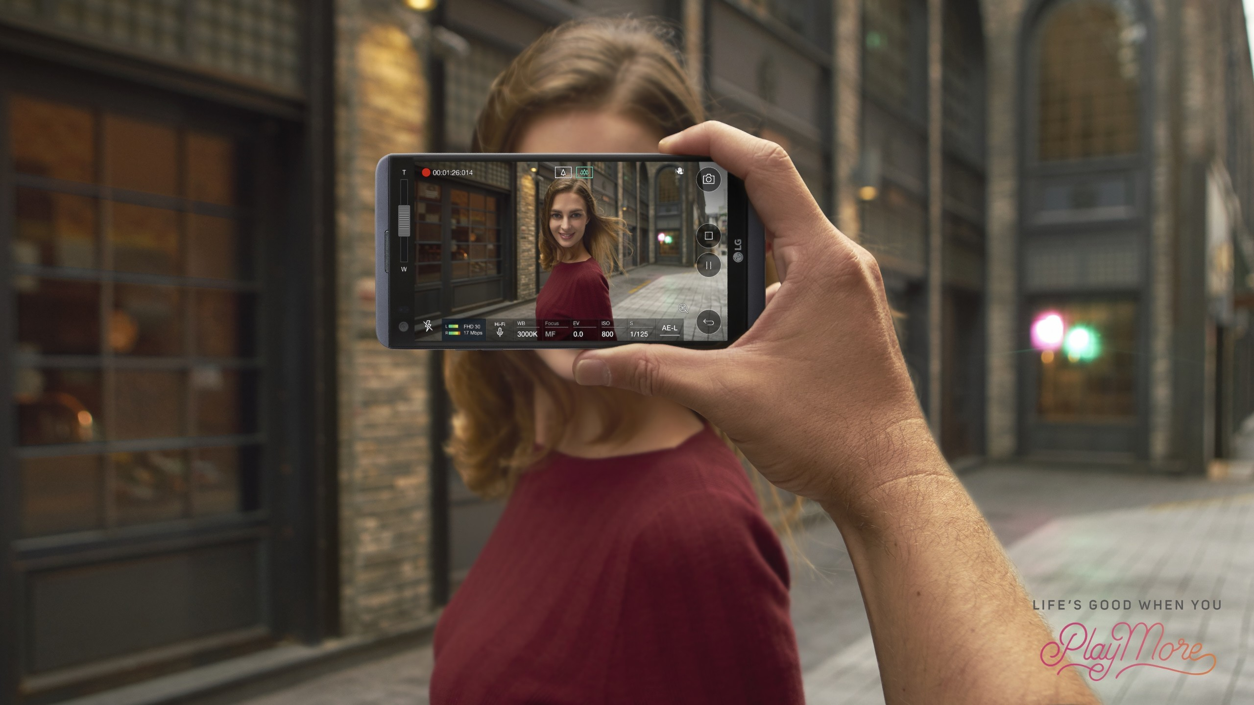 A person recording a woman with the LG V20's Steady Record 2.0 feature