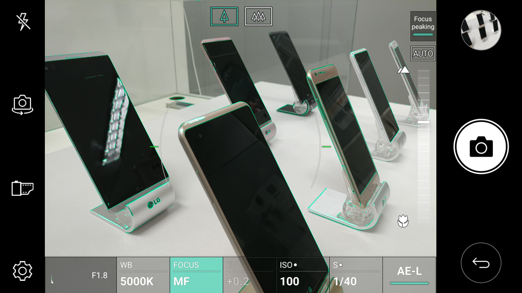 Several LG V20's displayed at an angle; image is framed by LG V20 camera interface with Focus Peaking feature on