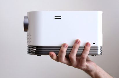 A hand is holding LG ProBeam showing its side view