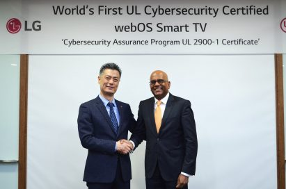 Hwang Jeong-hwan, head of R&D Laboratory of Home Entertainment at LG Electronics, shakes hands with Sajeev Jesudas, CEO of consumer business at Underwriters Laboratories