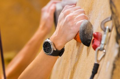 LG Watch Urbane 2 shown on wrist of person doing in-door rock climbing
