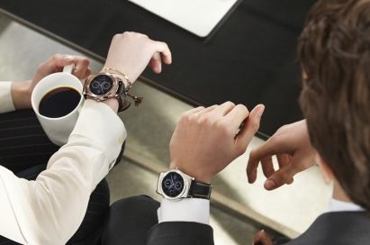 Male and female business people wearing LG Watch Urbane and enjoying a cup of coffee