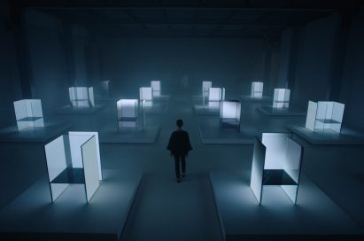 A woman walks through a number of the OLED panel installation of Tokujin Yoshioka at the exhibition venue.