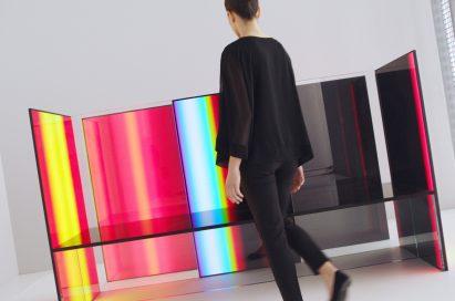 A woman beholds Tokujin Yoshioka's OLED panel installation artwork.