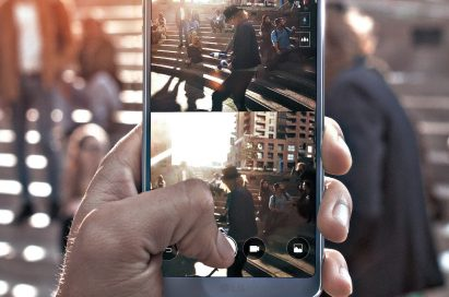 A person taking a Snap Shot of a man juggling with the LG G6's Square Camera Mode