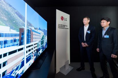 Two men observe the incredible picture quality and unmatched frame rate of the LG OLED TV at the SES Industry Days conference.