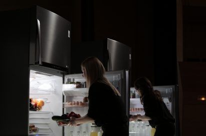 Two female musicians take food from LG's advanced refrigerators.