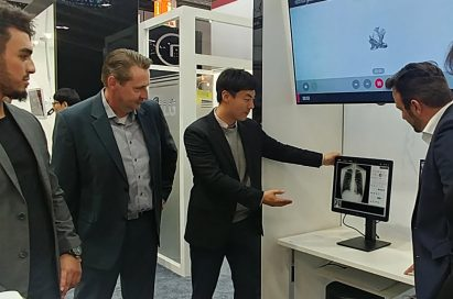 An LG representative demonstrates LG Medical Monitors to medical professionals at Medica 2017
