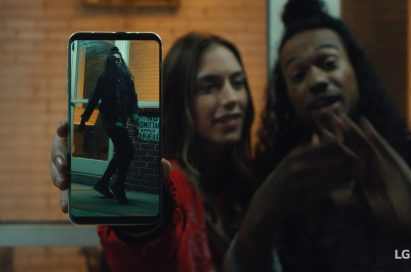 An image from the video clip shows Caroline Blaike standing next to Shaheem Sanchez while she holds LG V30 out towards the screen