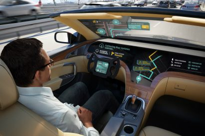 A model poses in a car equipped with HERE Technologies (HERE), a global provider of digital mapping and location services