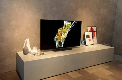 The LG OLED TV (model 65E8) displayed in the LG CES booth, a space designed to resemble a living room