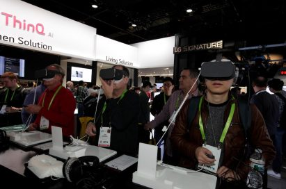 Visitors testing the VR devices connected to LG smartphones in LG's CES booth