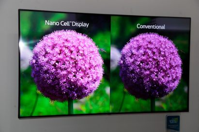 The LG Nano Cell SUPER UHD TV display compares two flower images side-by-side to showcase the superior imagery that comes with Nano Cell technology.