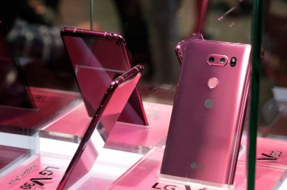 Several LG Raspberry Rose V30 smartphones showcased inside a glass display at LG's CES 2018 booth.