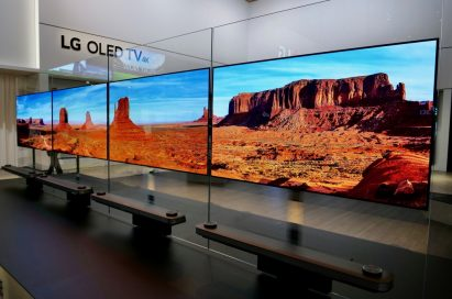 Another view of four LG SIGNATURE OLED TV W sets placed side by side on a display stand at LG's booth