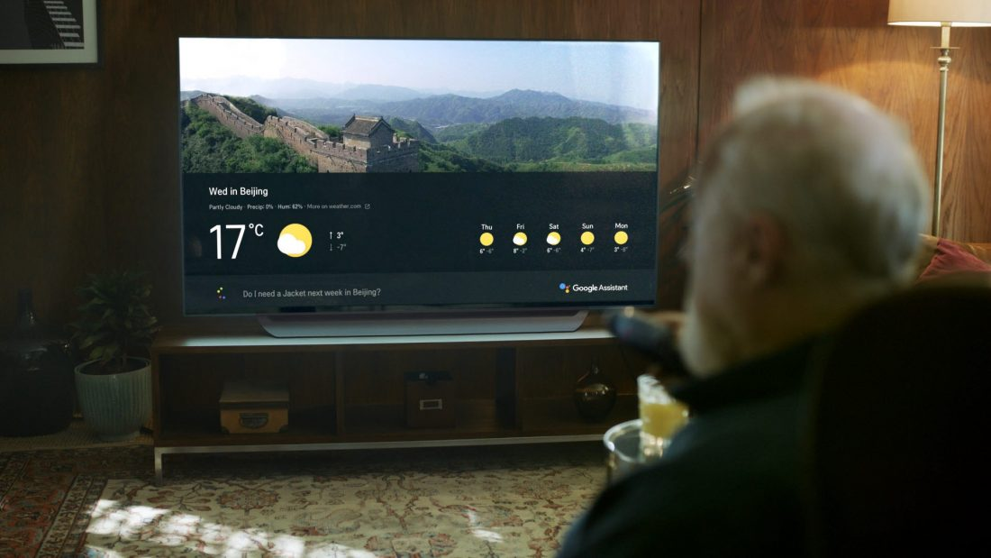 An old man asks LG's ThinQ-enabled TV for the weather forecast of Beijing for his travel.