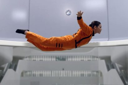 """A screenshot of LG India's """"Astronaut"""" video, there are a woman who in in an astronaut training inside a special facility."""