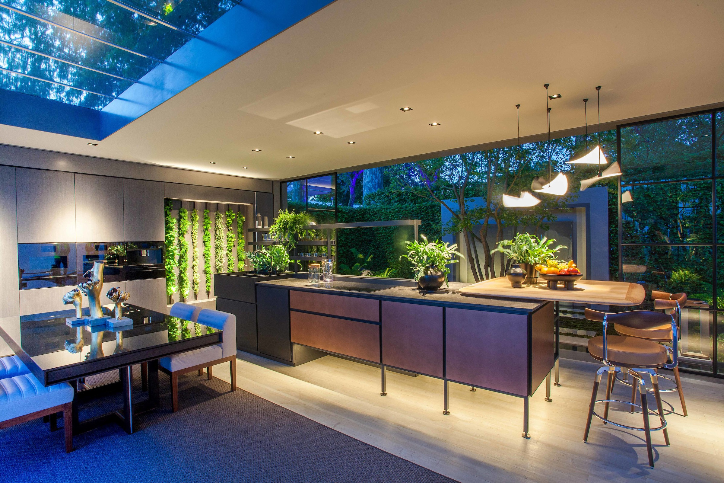 An inside view of LG Eco-City Garden with furniture, flowers and home appliances