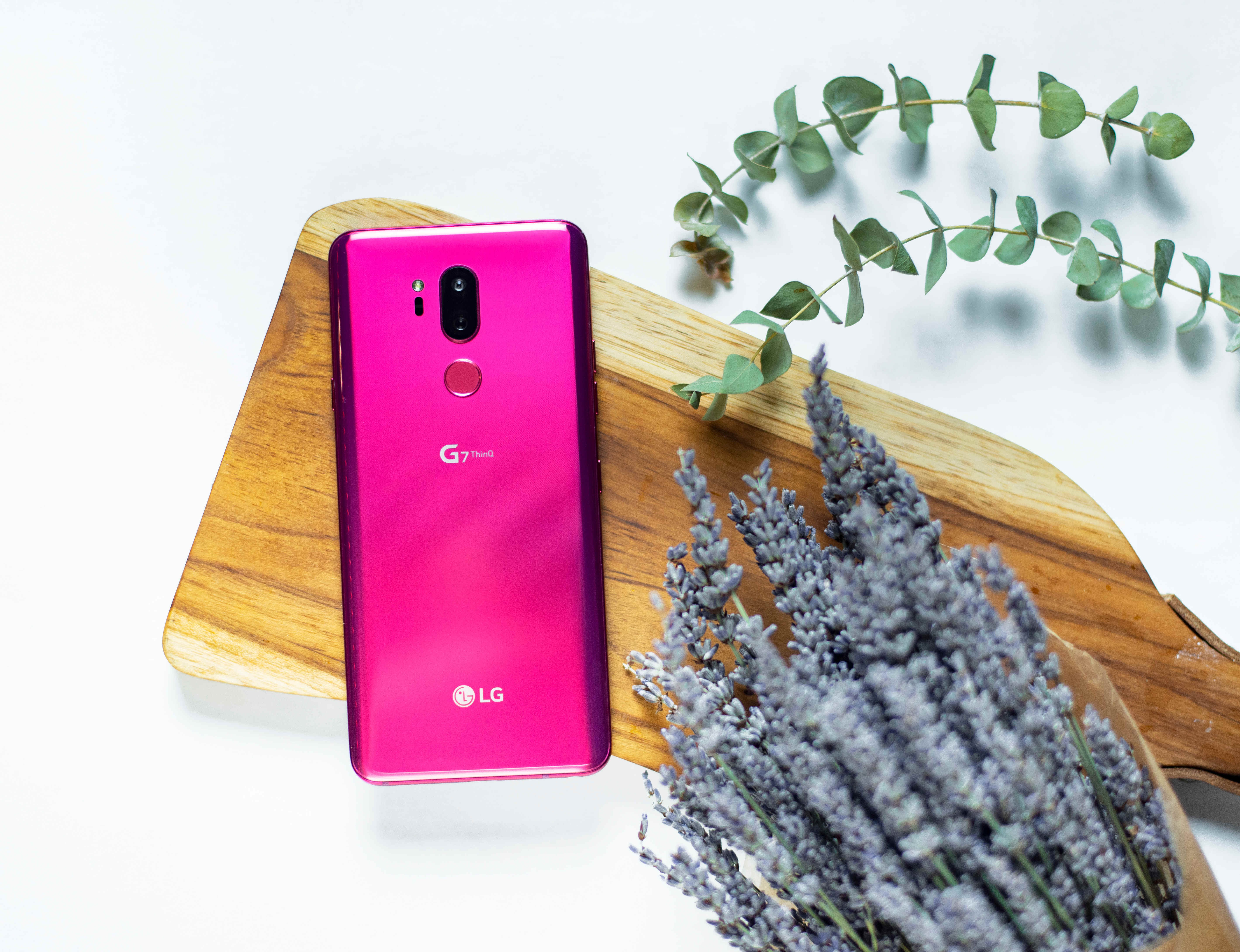 The LG G7 ThinQ in Raspberry Rose face down on a cutting board