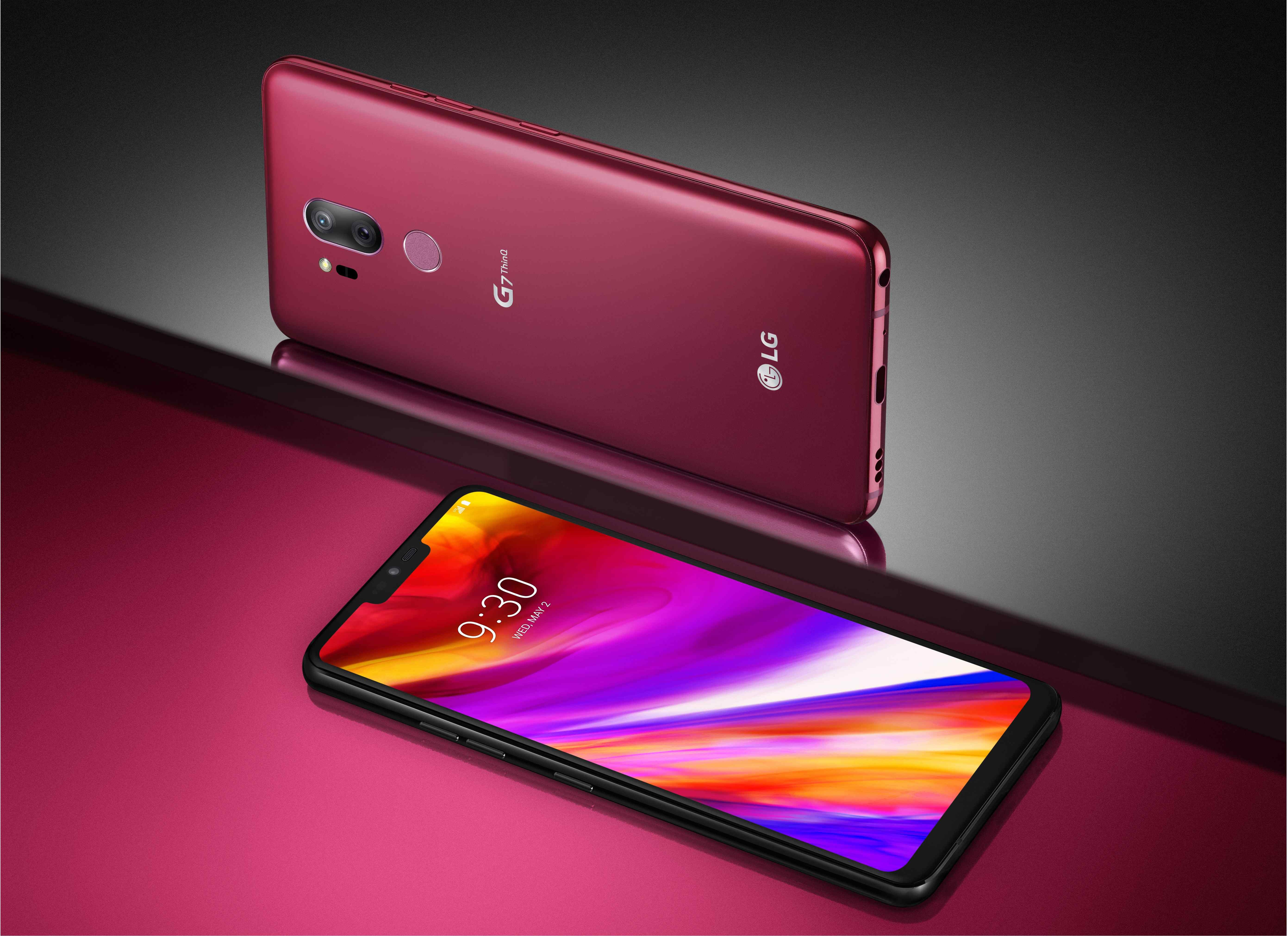 The front and rear view of the LG G7 ThinQ in Raspberry Rose against a gray and pink background