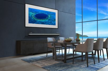 LG SIGNATURE OLED TV W in a modern-designed kitchen displays an image of Belize's Great Blue Hole on its screen.